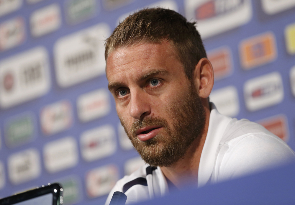 Italy's national soccer player Daniele De Rossi answers reporter's question during a news conference ahead of the Euro 2012 in Krakow June 8, 2012. REUTERS/Tony Gentile (POLAND - Tags: SPORT SOCCER)