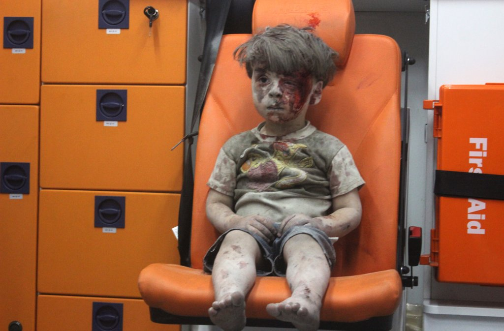 august-17-wounded-syrian-child-omran-daqneesh-sits-ambulance-after-air-strikes-his-aleppo-neighbourhood