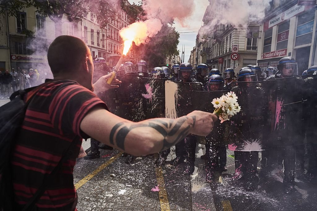 may-26-protester-lyon-france-held-flowers-torch-while-demonstrating-against-government-labour-reforms