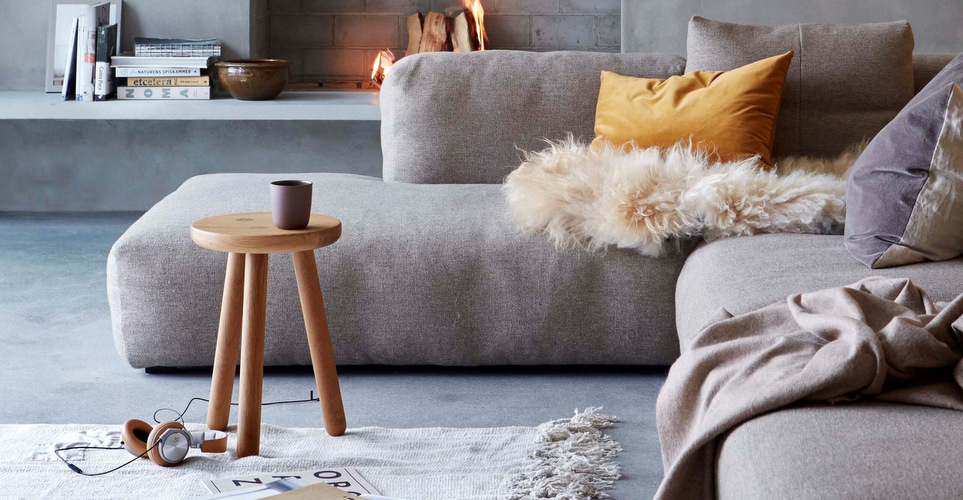 nonagon-style-n9s-warm-home-cozy-fireplace-gray-faux-fur-hygge-sofa-yellow-rug-1