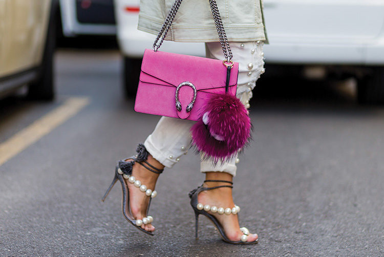 nina-schwichtenberg-wearing-pink-gucci-bag-pants-and-heels-with-pearls-outside-dolce-gabbana-during-milan-fashion-week-springsummer-2017-on-september-25-2016-750x502