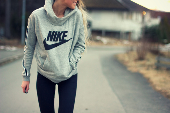 woman-wearing-nike-sweatshirt-walking-outdoor