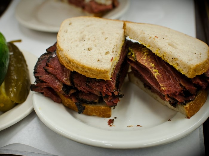 bite-into-the-legendary-pastrami-on-rye-from-katzs-delicatessen-in-new-york-stacks-of-juicy-meat-are-cut-thick-and-served-on-rye-bread-with-mustard-and-a-side-of-pickles-custom