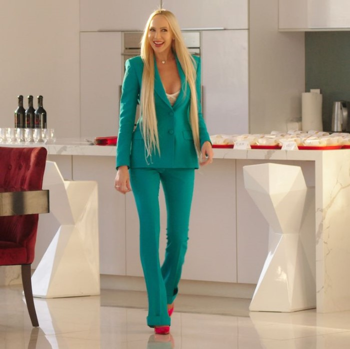 Quinn paired a teal Moschino suit with Louboutin heels.