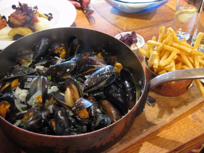 dig-into-a-steaming-bowl-of-moules-frites-in-belgium-custom