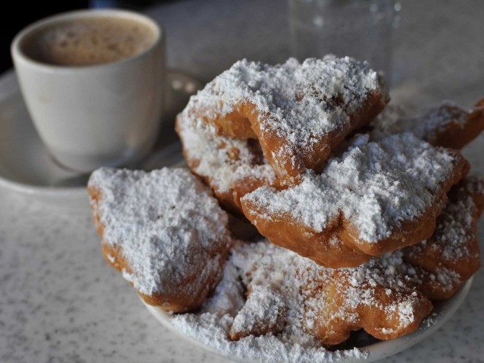 get-some-fresh-hot-beignets-a-type-of-deep-fried-pastry-topped-with-powdered-sugar-the-most-famous-place-to-try-them-is-cafe-du-monde-in-new-orleans-custom