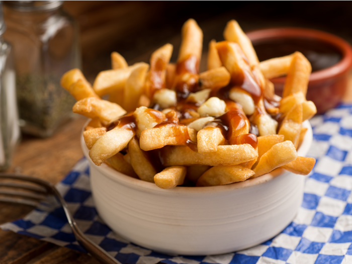 head-to-la-banquise-in-montreal-for-a-scrumptious-plate-of-poutine-crisp-french-fries-that-have-been-smothered-in-brown-gravy-and-cheese-curds-custom
