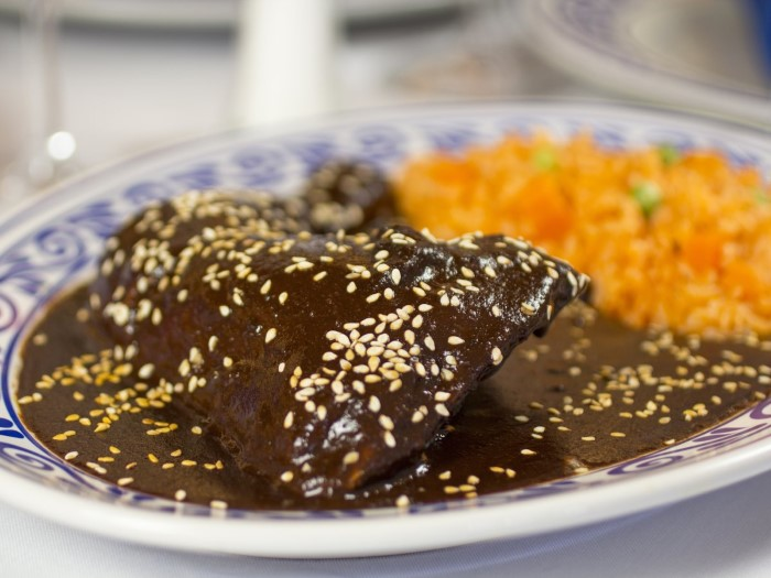 in-puebla-mexico-enjoy-the-complex-flavors-of-mole-poblano-a-thick-sauce-that-is-made-with-chili-peppers-and-chocolate-and-served-over-chicken-custom
