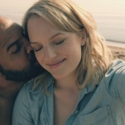 "The Handmaid's Tale  -- ""Offred"" -- Episode 101 --  Offred, one the few fertile women known as Handmaids in the oppressive Republic of Gilead, struggles to survive as a reproductive surrogate for a powerful Commander and his resentful wife. Luke (O-T Fagbenle) and Offred (Elisabeth Moss), shown. (Photo by: George Kraychyk/Hulu)"