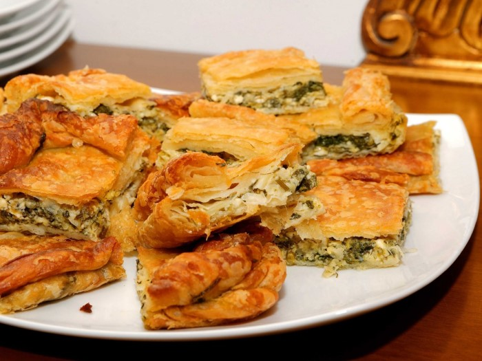 peel-off-a-crispy-flaky-layer-of-fresh-spanakopita-a-feta-and-spinach-pie-thats-served-all-over-greece-custom