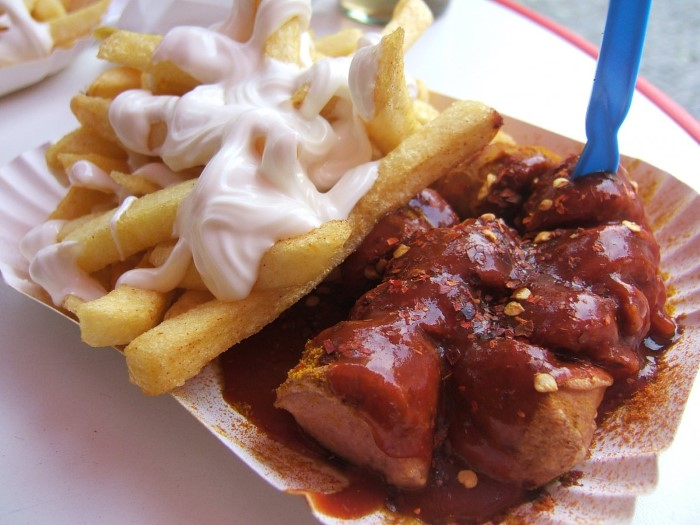 sample-berlins-iconic-street-food-currywurst-which-is-a-pork-sausage-thats-cut-into-slices-and-doused-with-curry-ketchup-berliners-love-konnopke-imbiss-located-in-the-prenzlauer-berg-neighborhood-cus