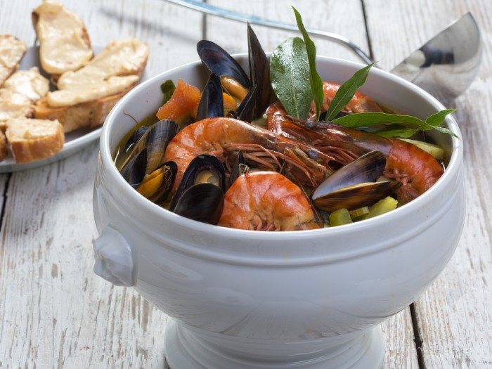 spoon-up-the-flavors-of-a-traditional-marseille-bouillabaisse-a-fish-stew-that-typically-includes-rascasse-grondin-conger-and-just-the-right-amount-of-saffron-custom