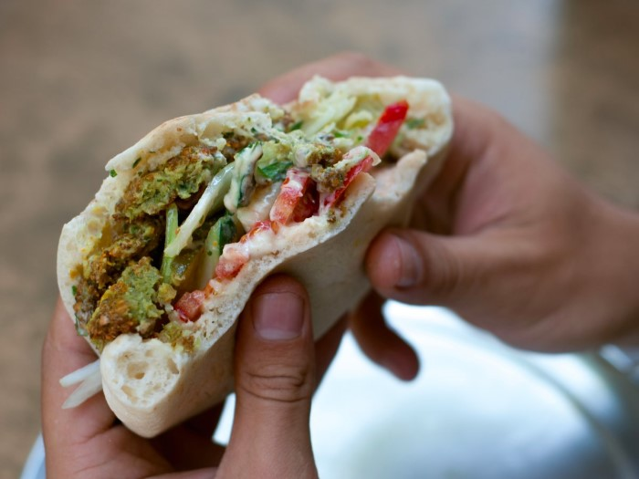 take-a-bite-out-of-a-crispy-fresh-falafel-sandwich-overstuffed-with-vegetables-in-amman-jordan-al-quds-and-abu-staif-are-some-of-the-most-famous-falafel-shops-custom