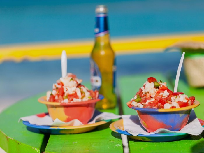 while-in-the-bahamas-cool-off-with-a-bowl-of-fresh-conch-salad-and-a-cold-kalik-beer-while-listening-to-the-waves-and-burying-your-feet-in-the-sand-custom