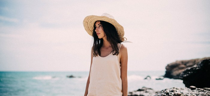 wide-brim-straw-hat-nude-top-ripped-denim-shorts-moody-tumblr-photo-on-the-beach